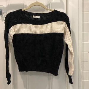 Cropped black knit sweater with cream stripe